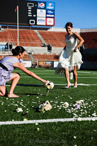 The bride is not afraid to get her Manolo Blahnik wedding shoes dirty. She takes a step forward to kick a field goal with her bridal bouquet.