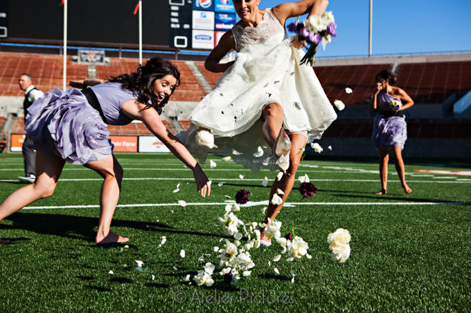 The flower petals go flying as the bride uses her Manolo Blahnik luxury wedding shoes to kick a field goal with her bouquet