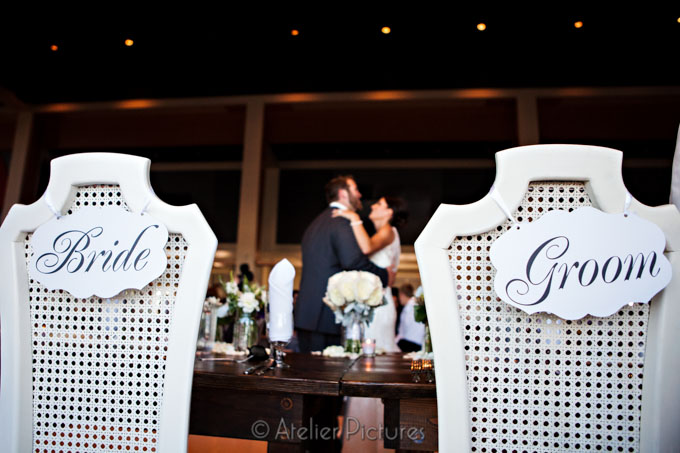 A sign to mark the bride and groom's chairs at the wedding reception, as they dance for the first time as husband and wife