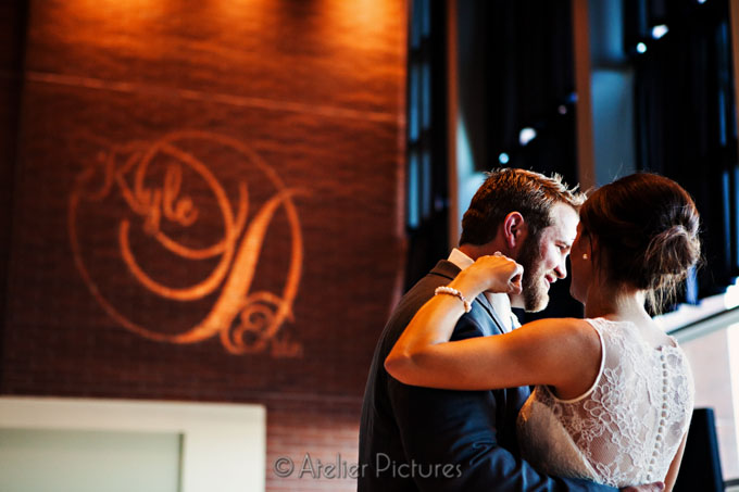 The gobo highlights the brick wall as the couple dances at their Corvallis wedding