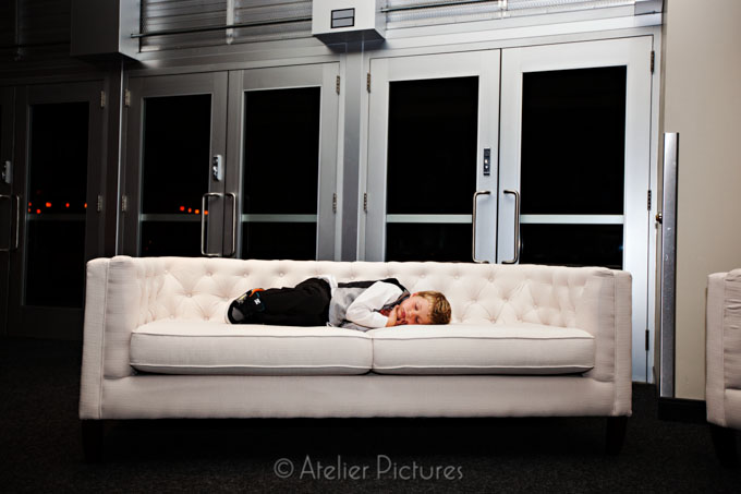 The ring bearer tried to dance all night, but the couch was calling him to sleep at Reser Stadium