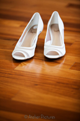 Gorgeous wedding shoes on a wooden floor