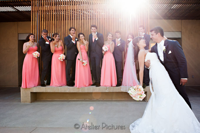 The bridesmaids and groomsmen get excited for their friends during the Scripps Seaside Forum Wedding