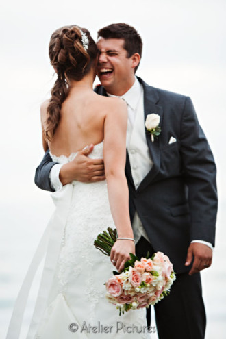 The bride and groom could not hold back their smiles through the wedding at the Scripps Seaside Forum