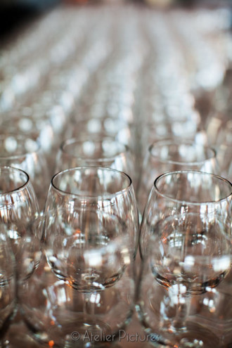 Rows of wine glasses ready for the wedding reception guests