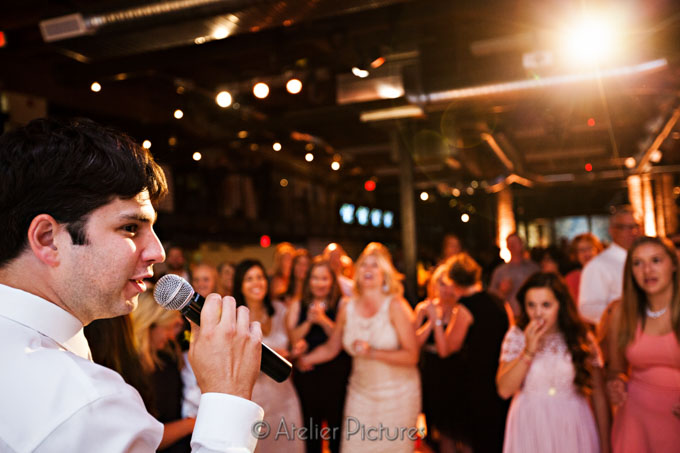 The groom took the mic at the LeftBank Annex to sing a special song