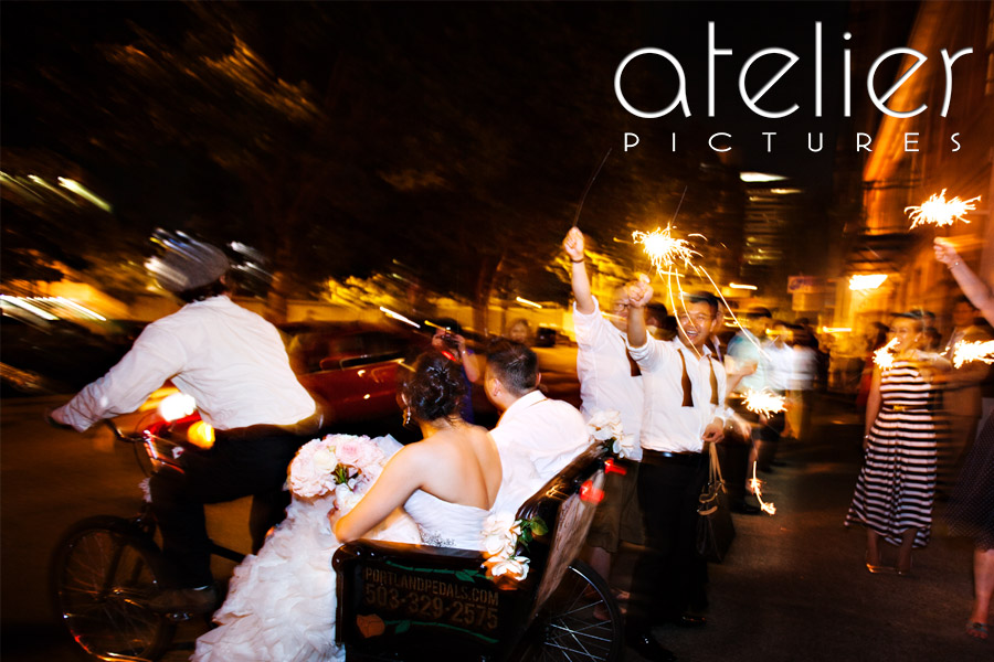 The bride and groom ride away in the pedicab from the West End Ballroom as their friends and family wave sparklers.