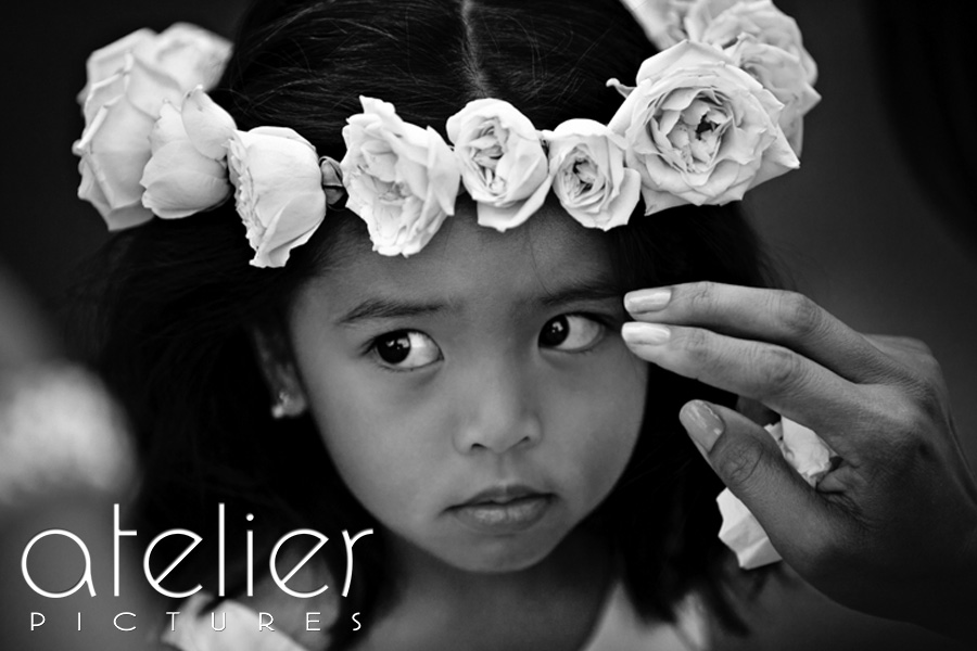 A photo of the flower girl with her gorgeous crown of roses