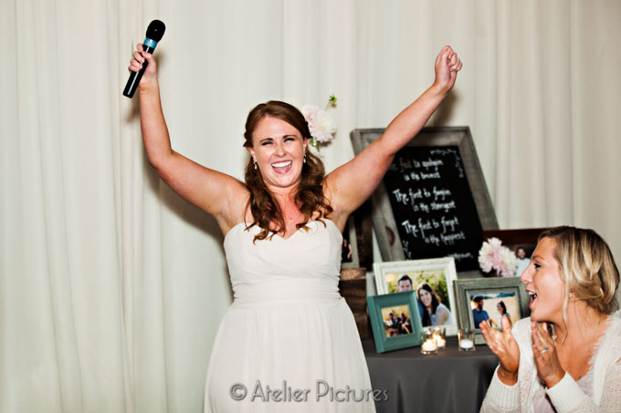The maid of honor enjoyed her moment of entertaining the guests with hilarious stories