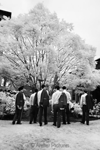 The groomsmen walking together , in infrared