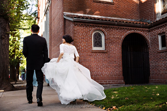 The bride and groom together as they depart St. Mary's Cathedral in Portland