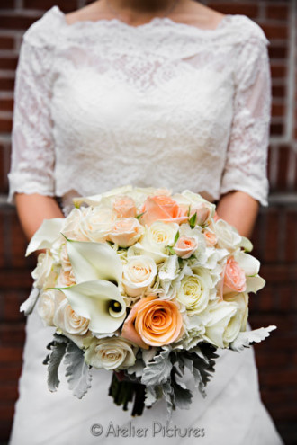 The bride holds her beautiful bouquet