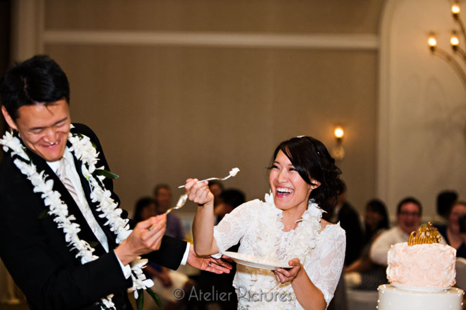 The bride threatens to smear the cake on her groom