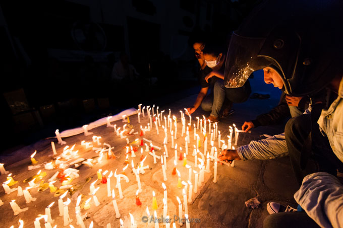 A candlelight vigil for those who perished in the earthquake.