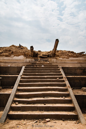Stairs, beams, and rubble highlighted the absence of former str